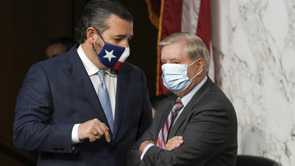 Sen. Ted Cruz speaks with Sen. Lindsey Graham on Capitol Hill during October's Supreme Court confirmation hearings.