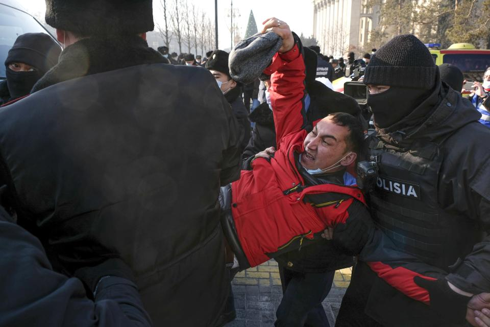 Kazakhstan's police officers detain a protester during an opposition rally in Almaty, Kazakhstan, Sunday, Jan. 10, 2021, as voters in resource-rich Kazakhstan are going to the polls in a parliamentary election lacking any serious opposition. Dozens of activists were detained in at least three major cities, including the capital, Nur-Sultan, and Almaty, with reports of independent observers being denied access or detained at some polling stations. (AP Photo/Vladimir Tretyakov)