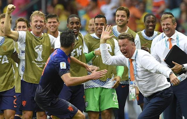 In this Friday, June 13, 2014 photo, Netherlands' Robin van Persie celebrates with head coach Louis van Gaal after scoring a goal during the group B World Cup soccer match between Spain and the Netherlands at the Arena Ponte Nova in Salvador, Brazil. (AP Photo/Manu Fernandez)