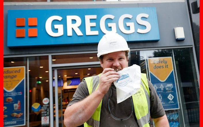 A happy day for all: Chris Heppell outside a branch of Greggs in Leeds as the bakery chain reopens 800 stores across the UK - PA