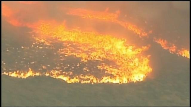 Gusty, hot winds blew an Arizona blaze out of control in a forest northwest of Phoenix killing 19.
