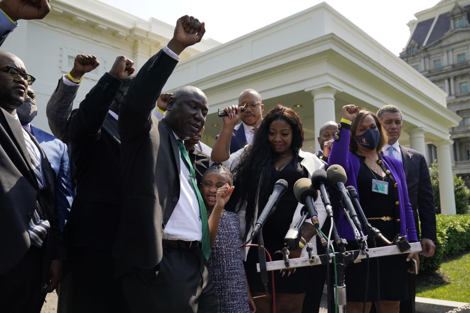 Benjamin Crump, front center, along with Gianna Floyd, daughter of George Floyd, and her mother Roxie Washington, and others talk with reporters after meeting with President Joe Biden at the White House, Tuesday, May 25, 2021, in Washington. (AP Photo/Evan Vucci)