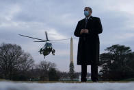 Marine One, with President Joe Biden aboard, approaches the South Lawn of the White House, Friday, Feb. 19, 2021, in Washington. Biden is returning to Washington after visiting Pfizer's COVID-19 vaccine manufacturing site near Kalamazoo, Mich. (AP Photo/Patrick Semansky)