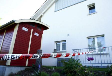 A police ribbon is seen in front of a house in Wuerenlingen, Switzerland May 10, 2015. REUTERS/Ruben Sprich