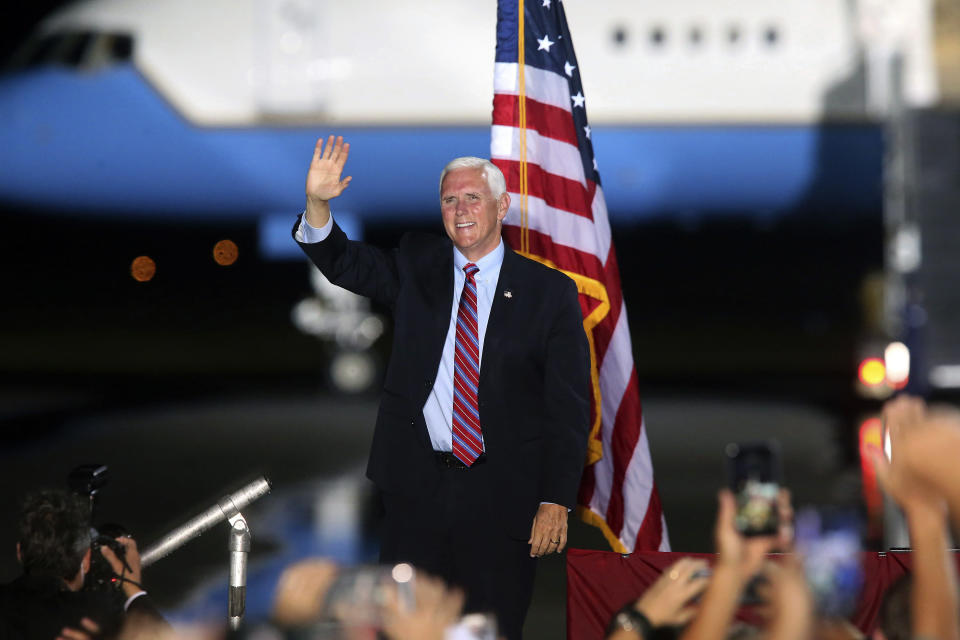 Vice President Mike Pence waves to supporters Saturday Oct. 24, 2020 in Tallahassee, Fla. Battleground Florida was again a central focus of the presidential campaign Saturday as President Donald Trump, Vice President Mike Pence and former President Barack Obama all had high-profile events in the state. (AP Photo/Steve Cannon)