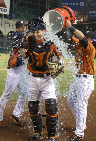Houston Astros' Cody Clark, center, is doused by teammates Jarred Cosart, left, and Brandon Laird after a baseball game against the Los Angeles Angels on Friday, Sept. 13, 2013, in Houston. Clark got his first hit in the majors and scored a run in the Astros' 9-7 win. (AP Photo/Pat Sullivan)
