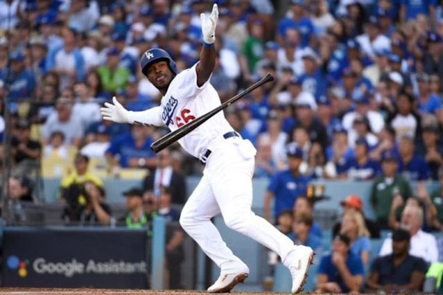 Yasiel Puig celebrates his clutch RBI single for the Dodgers in NLCS Game 5. (Getty Images)