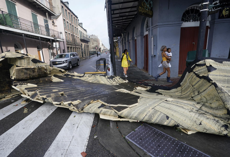 A roof blown off a building in the French Quarter by Hurricane Ida blocks an intersection Monday in New Orleans.