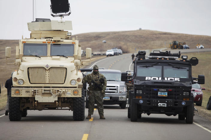 <p>A North Dakota law enforcement officers stands next to two armored vehicles just beyond the police barricade on Highway 1806 near a Dakota Access Pipeline construction site near the town of Cannon Ball, N.D., on Oct. 30, 2016. (Josh Morgan/Reuters) </p>