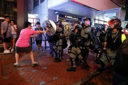 Riot police confront a protester near Causeway Bay MTR station in Hong Kong