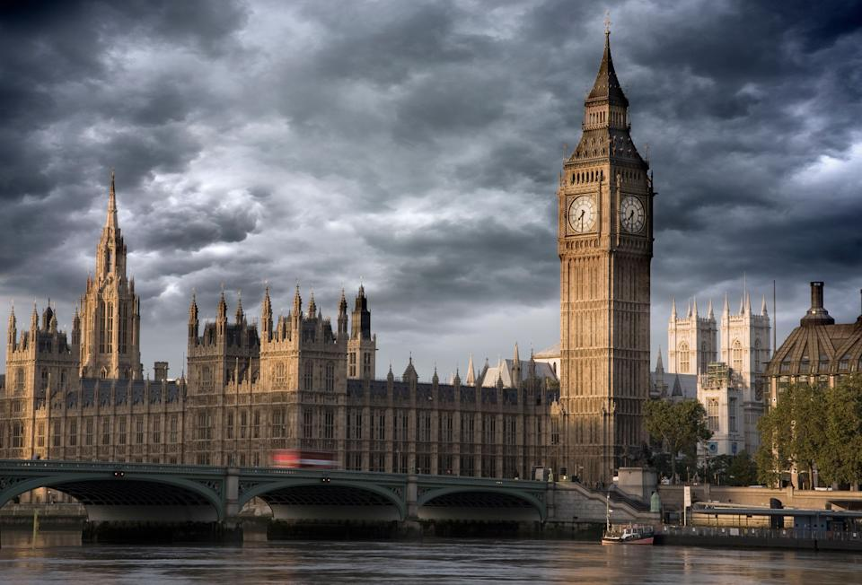 UK London Big Ben and Westminster bridge viewed over the river Thames stormy Skies (Photo: Travelpix Ltd via Getty Images)