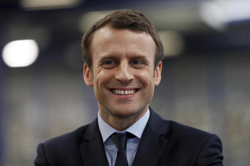 French presidential election candidate for the En Marche ! movement Emmanuel Macron reacts during his visit at the KRYS group's headquarters in Bazainville, near Paris Tuesday April 18, 2017. The two-round presidential election is set for April 23 and May 7. (Thomas Samson/ pool photo via AP)