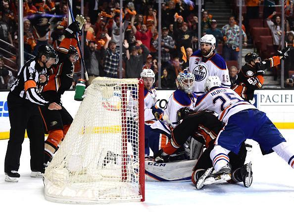 "ANAHEIM, CA – MAY 05: <a class=""link rapid-noclick-resp"" href=""/nhl/players/4854/"" data-ylk=""slk:Cam Talbot"">Cam Talbot</a> #33 of the <a class=""link rapid-noclick-resp"" href=""/nhl/teams/edm/"" data-ylk=""slk:Edmonton Oilers"">Edmonton Oilers</a> looks back at the net as <a class=""link rapid-noclick-resp"" href=""/nhl/players/5391/"" data-ylk=""slk:Rickard Rakell"">Rickard Rakell</a> #67 of the <a class=""link rapid-noclick-resp"" href=""/nhl/teams/ana/"" data-ylk=""slk:Anaheim Ducks"">Anaheim Ducks</a> scores a goal to tie the game 3-3 with fifteen seconds remaining during the third period in Game Five of the Western Conference Second Round during the 2017 NHL Stanley Cup Playoffs at Honda Center on May 5, 2017 in Anaheim, California. (Photo by Harry How/Getty Images)"