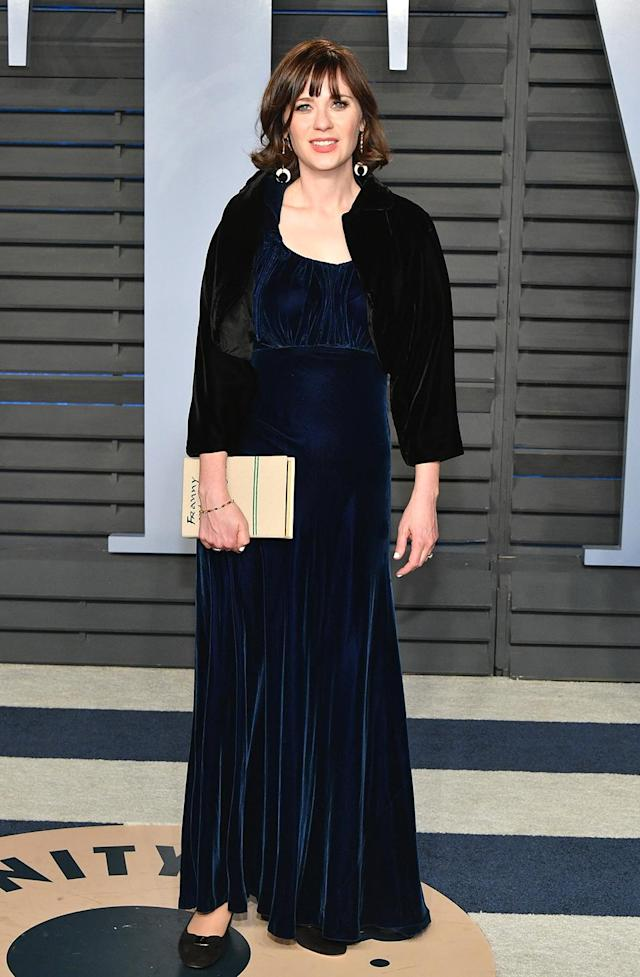 <p>New girl, Old Hollywood. Deschanel's velvet gown and capelet had a vintage influence. (Photo: Dia Dipasupil/Getty Images) </p>