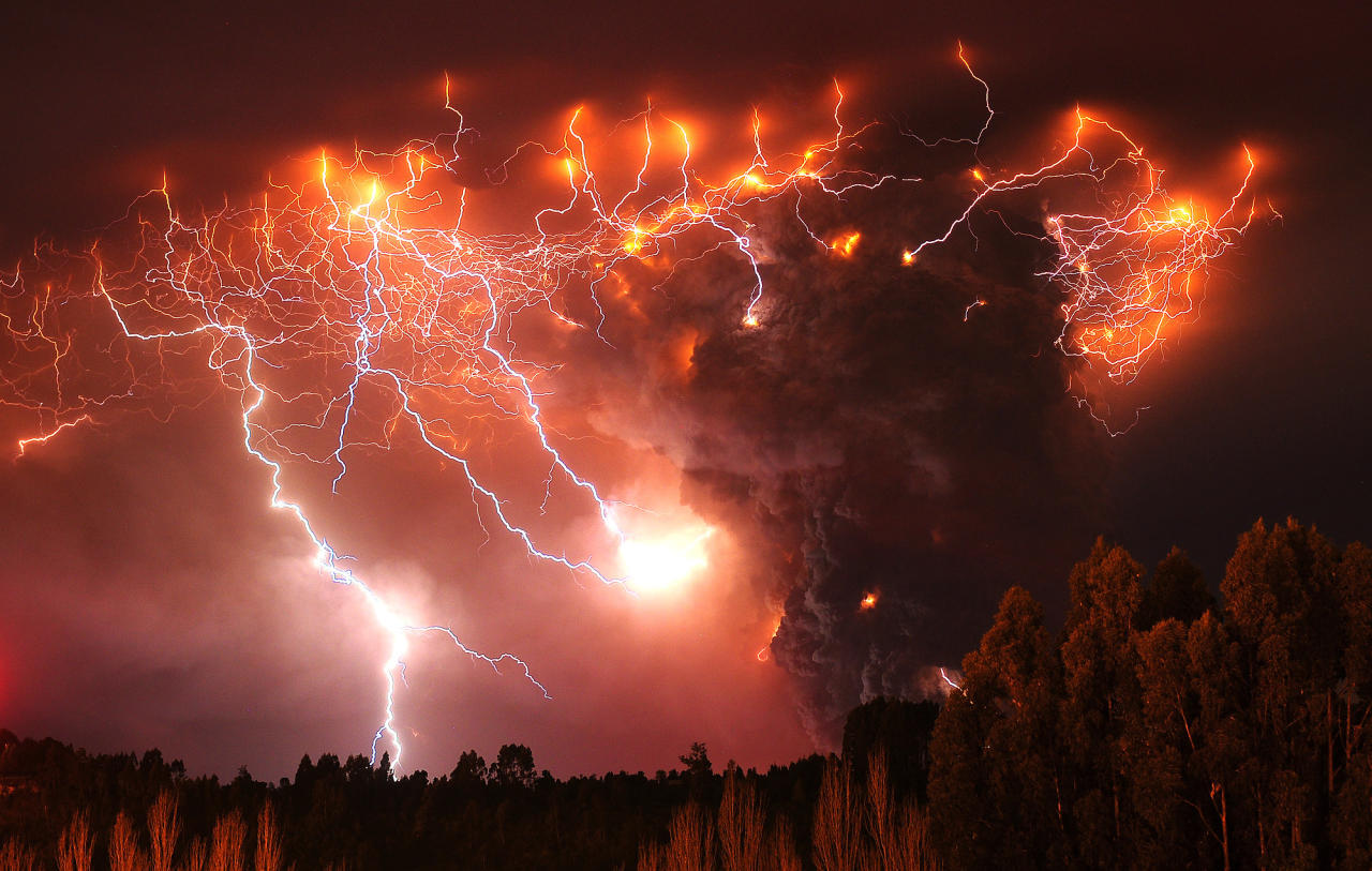 Lightning strikes over the Puyehue volcano, over 500 miles south of Santiago, Chile, Monday June 6, 2011. Authorities have evacuated about 3,500 people in the nearby area. The volcano was calm on Monday, two days after raining down ash and forcing thousands to flee, although the cloud of soot it had belched out still darkened skies as far away as Argentina. (AP Photo/Francisco Negroni, AgenciaUno)