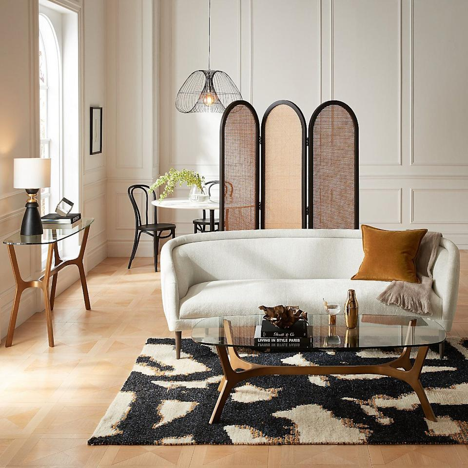 """As we mentioned before, <a href=""""https://fave.co/2HyThcK"""" target=""""_blank"""" rel=""""noopener noreferrer"""">Crate & Barrel</a> has its own line of<a href=""""https://fave.co/2G3ejCN"""" target=""""_blank"""" rel=""""noopener noreferrer"""">modern meets art deco collection</a>. For an art deco living room, you might turn toCrate & Barrel for a <a href=""""https://fave.co/32YylaB"""" target=""""_blank"""" rel=""""noopener noreferrer"""">brass and glass coffee table</a>, <a href=""""https://fave.co/2HrsYbz"""" target=""""_blank"""" rel=""""noopener noreferrer"""">black marble end table</a>or <a href=""""https://fave.co/32W00sF"""" target=""""_blank"""" rel=""""noopener noreferrer"""">velvety tub chair</a>. Maybe throw an <a href=""""https://fave.co/3j9yCwI"""" target=""""_blank"""" rel=""""noopener noreferrer"""">old-fashioned glass</a> that looks pretty old fashioned on your cart, too.<br /><br /><a href=""""https://fave.co/2HyThcK"""" target=""""_blank"""" rel=""""noopener noreferrer"""">Check outCrate & Barrel</a>."""