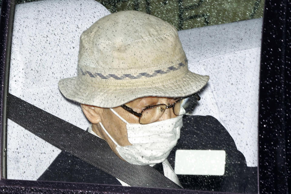Kozo Iizuka is driven to Tokyo District Court to hear the court's ruling on his car accident in Tokyo Thursday, Sept. 2, 2021. The court on Thursday sentenced the 90-year-old former top bureaucrat to five years in prison in a 2019 fatal car accident on a busy Tokyo street, killing a 3-year-old girl and her mother in a high-profile case in a fast-aging country where elderly driving has become a major safety concern. (Kyodo News via AP)