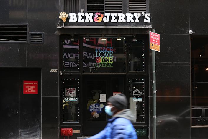 A person walks past Ben & Jerry's during the coronavirus pandemic in New York City. (Photo: Rob Kim via Getty Images)