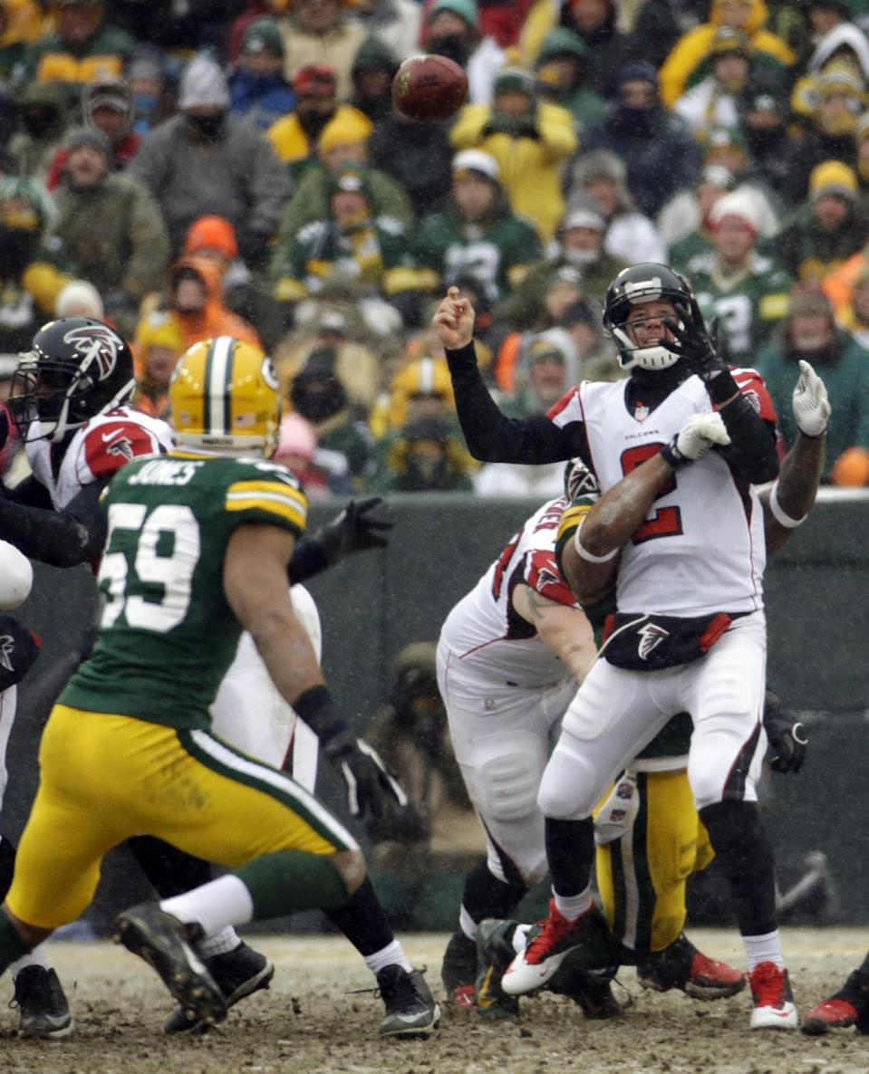 Atlanta Falcons' Matt Ryan fumbles as he is hit during the second half of an NFL football game against the Green Bay Packers Sunday, Dec. 8, 2013, in Green Bay, Wis. The Packers recovered the fumble. (AP Photo/Morry Gash)