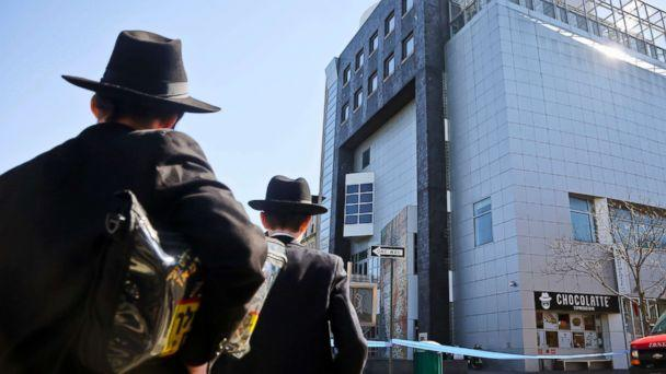 PHOTO: Two young men who left a nearby synagogue watch police activity outside the Jewish Children's Museum following a bomb threat in Brooklyn borough of New York, March 9, 2017. (Bebeto Matthews/AP Photo)