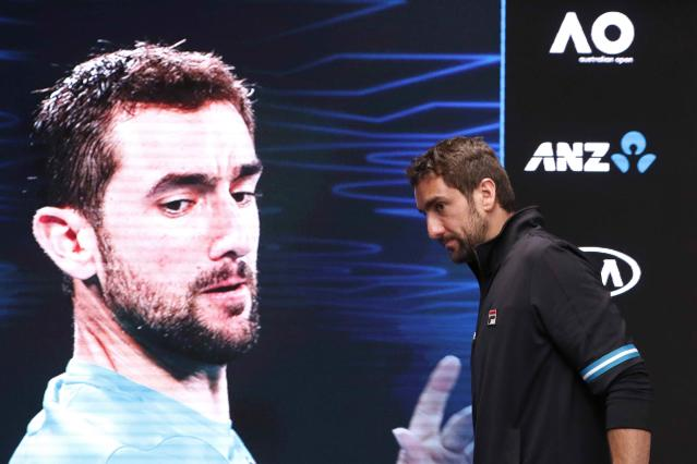 Tennis - Australian Open - Men's singles final - Rod Laver Arena, Melbourne, Australia, January 29, 2018. Croatia's Marin Cilic leaves a press conference after losing the final against Switzerland's Roger Federer. REUTERS/Edgar Su