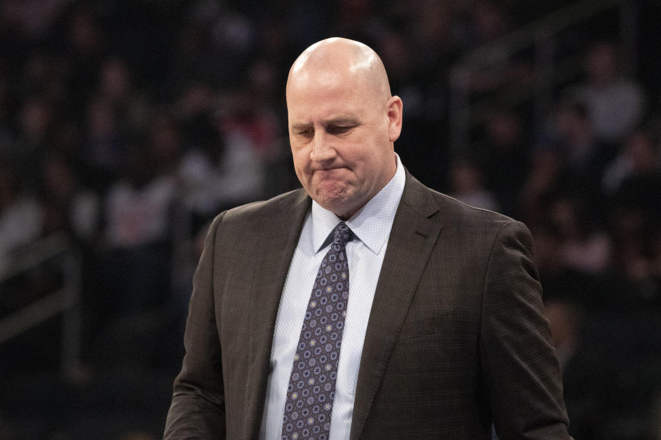 Jim Boylen in a suit and tie with distressed face.