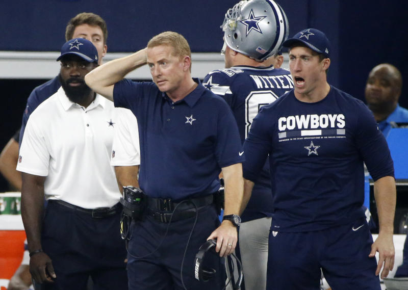 Dallas' Jason Garrett (middle) is 58-49 since 2011 as Cowboys head coach. (AP)