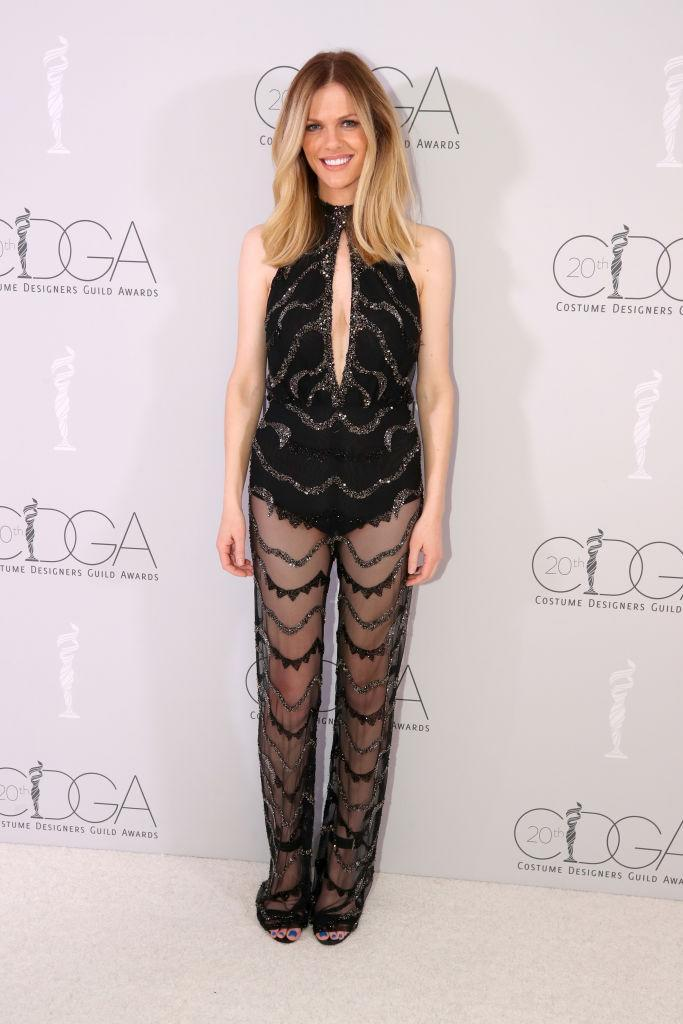 <p>Model Brooklyn Decker wears a sheer-pant jumpsuit at the 20th Costume Designers Guild Awards in February 2018. (Photo: Getty Images) </p>
