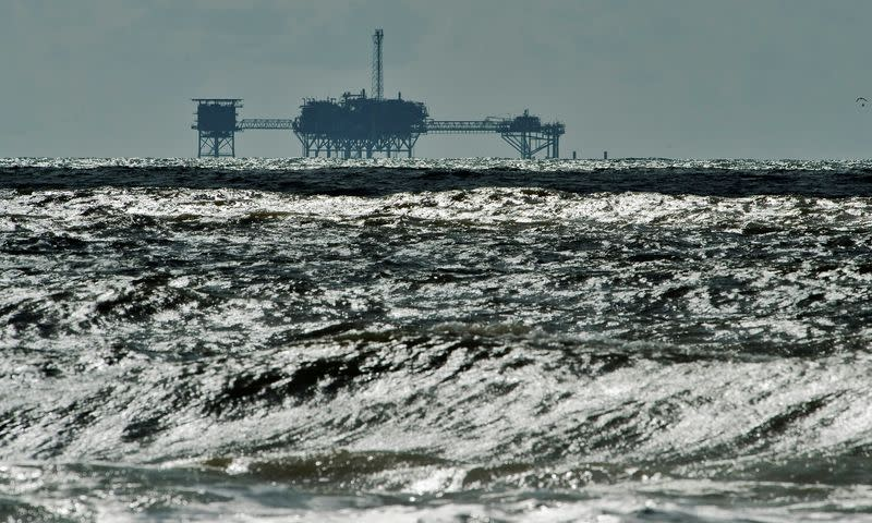 FILE PHOTO: FILE PHOTO: An oil and gas drilling platform stands offshore near Dauphin Island, Alabama