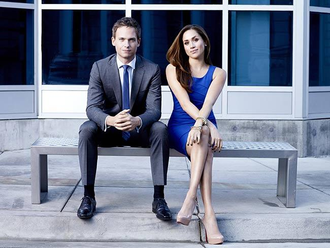 Meghan Markle sitting with Patrick J. Adams on a bench