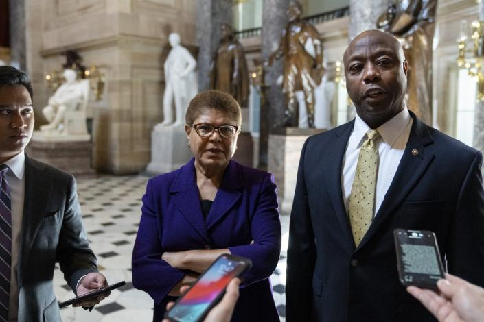 Two lawmakers, Democrat Rep. Karen Bass and GOP Sen. Tim Scott, talking with reporters after meeting on Capitol Hill to discuss police reform legislation.