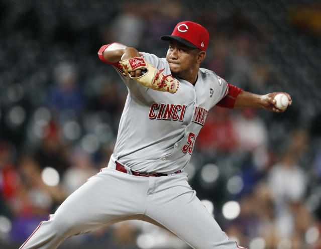 Cincinnati Reds relief pitcher Wandy Peralta works against the Colorado Rockies in the seventh inning of a baseball game Saturday, July 13, 2019, in Denver. (AP Photo/David Zalubowski)