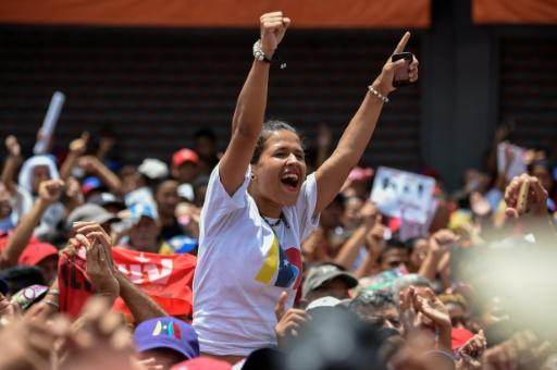 """A supporter of Venezuelan President Nicolas Maduro cheers during a campaign rally ahead of the presidential election which Washington has dismissed as a """"sham"""""""