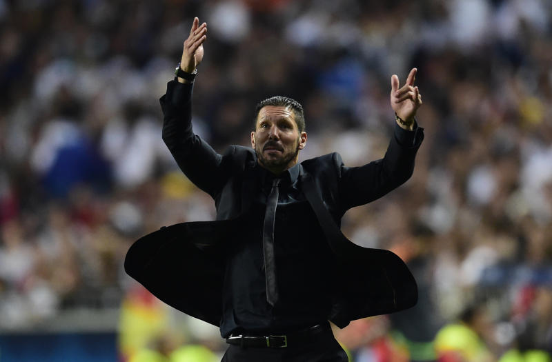 Atletico Madrid's Argentinian coach Diego Simeone reacts during the UEFA Champions League Final Real Madrid vs Atletico de Madrid at Luz stadium in Lisbon, on May 24, 2014
