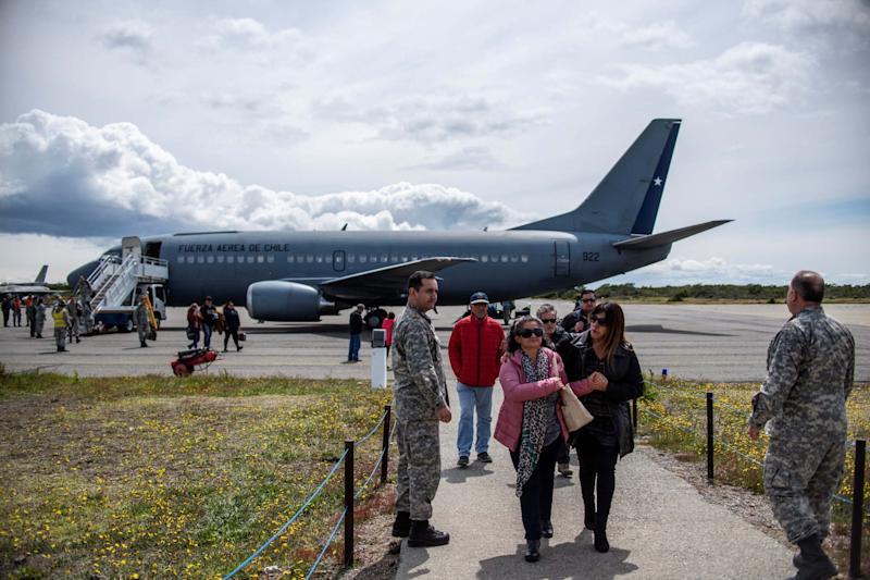 Relatives of the missing passengers arrive at the air force base in Punta Arenas (REUTERS)