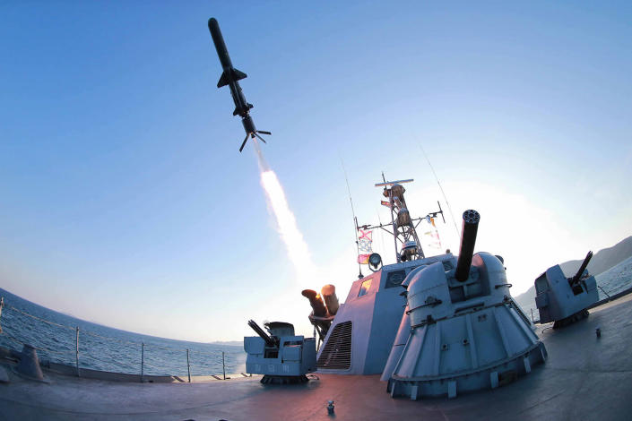 <p>A missile is fired from a naval vessel during the test-firing of a new type of anti-ship cruise missile to be equipped at Korean People's Army (KPA) naval units in this undated photo. (KCNA/Reuters) </p>