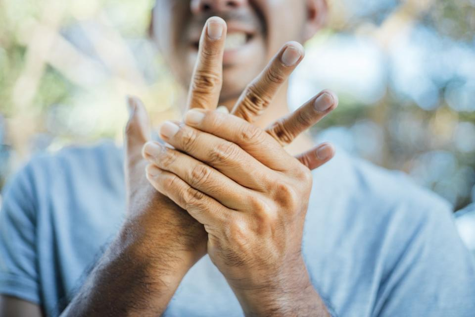 Man with swollen hand pain