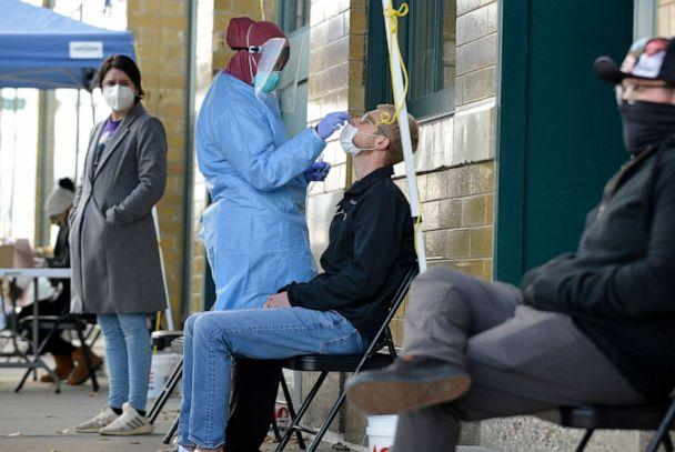 PHOTO: A medical staff member performs a Covid-19 test outside the Family Healthcare building in downtown Fargo, ND., Oct. 15, 2020. (Dan Koeck/Bloomberg via Getty Images)