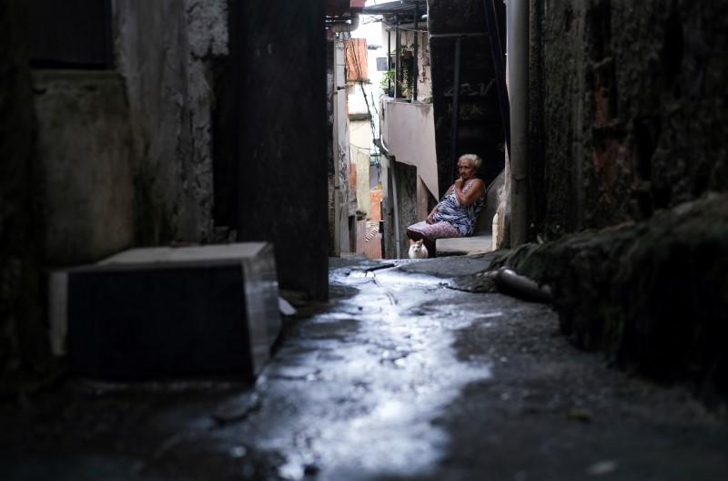 Maria das Neves, 76, is pictured in the Alemao slums complex during the coronavirus disease (COVID-19) outbreak, in Rio de Janeiro