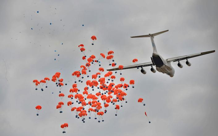 The WFP dropping food parcels in South Sudan - Tony Karumba/AFP