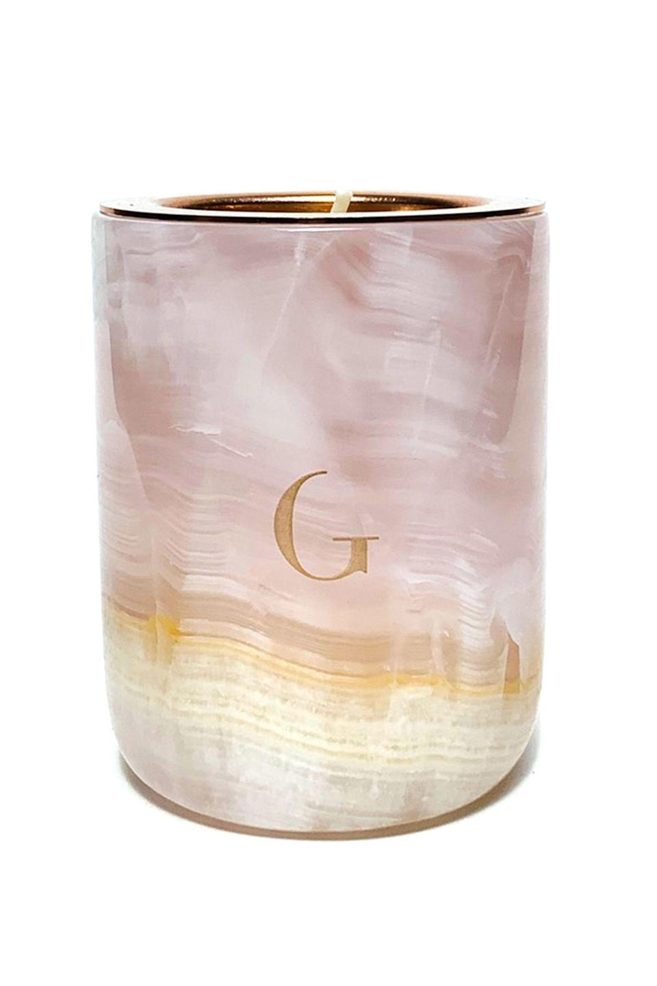 """<p><strong>Gilded Body</strong></p><p>gildedbody.com</p><p><strong>$68.00</strong></p><p><a href=""""https://gildedbody.com/collections/the-marble-candle/products/pink-onyx-marble-candle"""" rel=""""nofollow noopener"""" target=""""_blank"""" data-ylk=""""slk:Shop Now"""" class=""""link rapid-noclick-resp"""">Shop Now</a></p><p>When you've burned through this candle, simply order a wax refill from the same site and get lit again and again and again. </p>"""