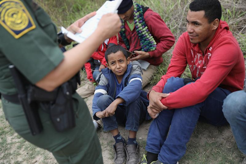 A U.S. Border Patrol agent checks birth certificates while taking Central American immigrants into detention on Jan. 4, 2017, near McAllen, Texas.