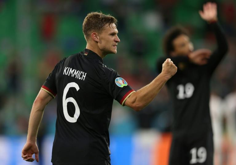 Germany defender Joshua Kimmich celebrates reaching the last 16 of Euro 2020