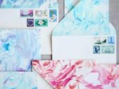 """<p>Did you know that you can create a """"marbled"""" effect on paper using a combo of shaving cream and food coloring? You can!</p><p><strong>Get the tutorial at </strong><strong><a href=""""https://honestlywtf.com/diy/diy-paper-marbling/"""" rel=""""nofollow noopener"""" target=""""_blank"""" data-ylk=""""slk:Honestly WTF's DIY"""" class=""""link rapid-noclick-resp"""">Honestly WTF's DIY</a>. </strong></p>"""