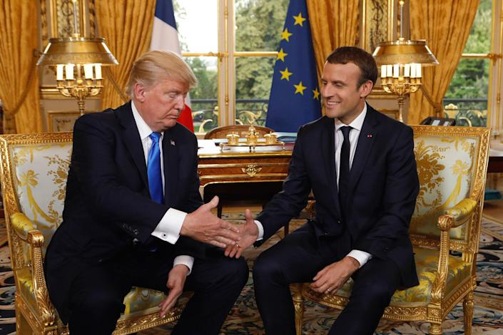 <p>French President Emmanuel Macron and President Donald Trump, left, shake hands as they meet at the Elysee Palace in Paris, France, Thursday, July 13, 2017. (Photo: Kevin Lamarque/Pool Photo via AP) </p>