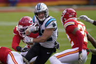 Carolina Panthers running back Christian McCaffrey, center, runs against the Kansas City Chiefs during the first half of an NFL football game in Kansas City, Mo., Sunday, Nov. 8, 2020. (AP Photo/Orlin Wagner)