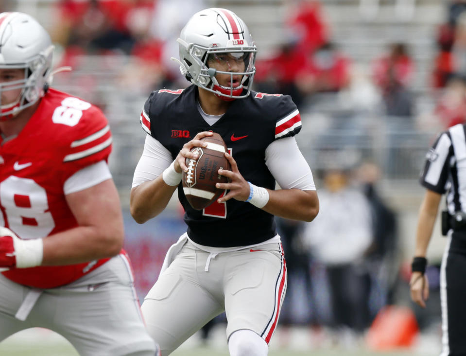 Ohio State quarterback C.J. Stroud drops back to pass during the Buckeyes' spring NCAA college football game in Columbus, Ohio, Saturday, April 17, 2021. (AP Photo/Paul Vernon)