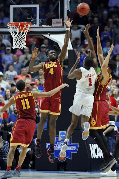 SMU guard Shake Milton (1) throws up an unsuccessful last second shot as Southern California's Jordan McLaughlin (11), Chimezie Metu (4) and Bennie Boatwright, right, defend in the second half of a first-round game in the men's NCAA college basketball tournament in Tulsa, Okla., Friday March 17, 2017. Southern California won 66-65. (AP Photo/Tony Gutierrez)
