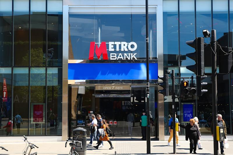 A Metro Bank branch is seen in London. Metro Bank�s shares dropped by 8\% on Monday 13 May 2019 leaving them 70\% lower for the year to date and concerns about the bank�s financial position. At its many branches, it has been reported that customers are queueing outside the bank after a WhatsApp message advising people to withdraw their money out of their accounts and empty safe deposit boxes. (Photo by Dinendra Haria / SOPA Images/Sipa USA)
