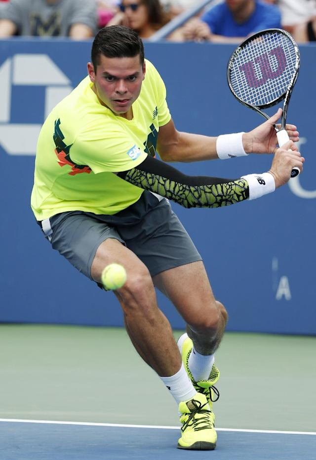 Milos Raonic, of Canada, returns a shot to Victor Estrella Burgos, of Dominican Republic, during the third round of the 2014 U.S. Open tennis tournament, Saturday, Aug. 30, 2014, in New York. (AP Photo/Kathy Willens)